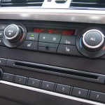 Anti-theft AM/FM stereo/CD/MP3 audio system with 12 speakers, 205-watt digital amplifier