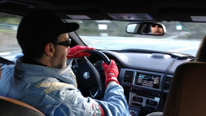 Adam Carolla Driving Jag In Firesuit