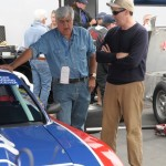 Adam Carolla and Jay Leno car talk in the paddack