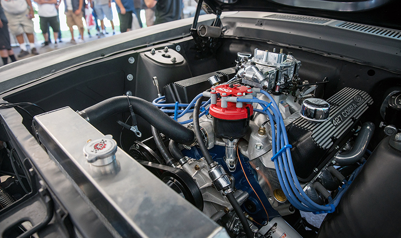 The '67 Fastback's Ford Performance 427 Cobra FE motor is fed via an Edelbrock manifold, topped by a Holly 750 double pumper.