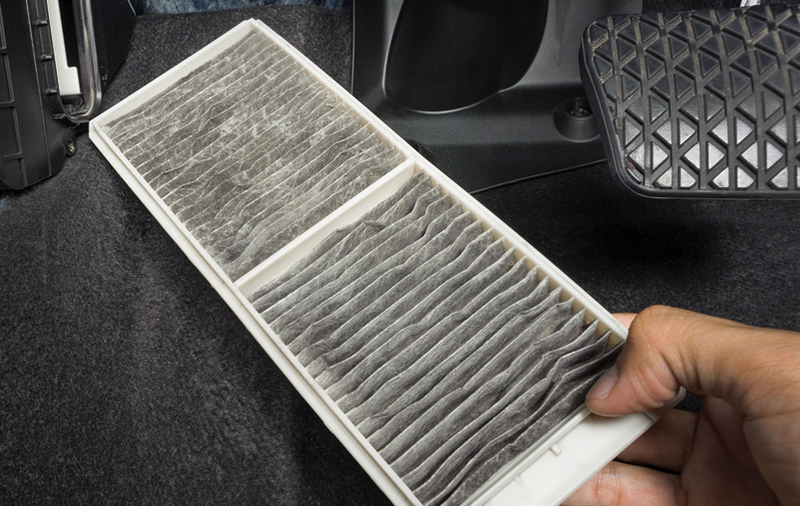 Car cabin air filter accessed from under the dashboard.