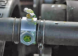 Use the bleeder valve to let out air trapped in the cooling system.