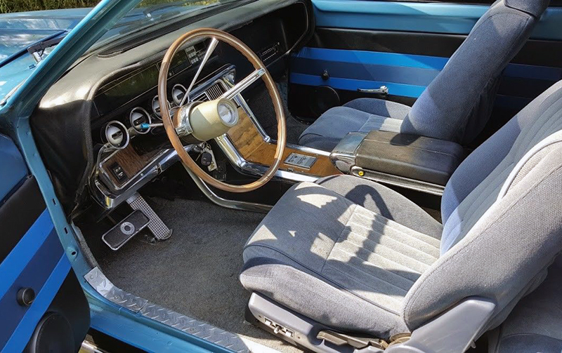 The interior is the most conventional part of the car, although a 1960s T-Bird coexists with a mid-80s Olds dashboard.